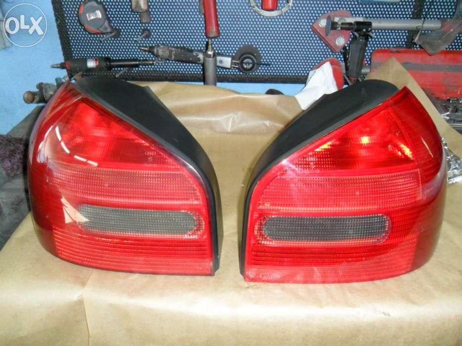 Par de farolins Audi A3 '98