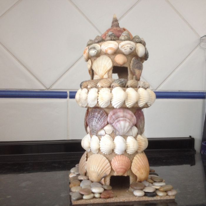 castelo feito com conchas tudo feito à mão