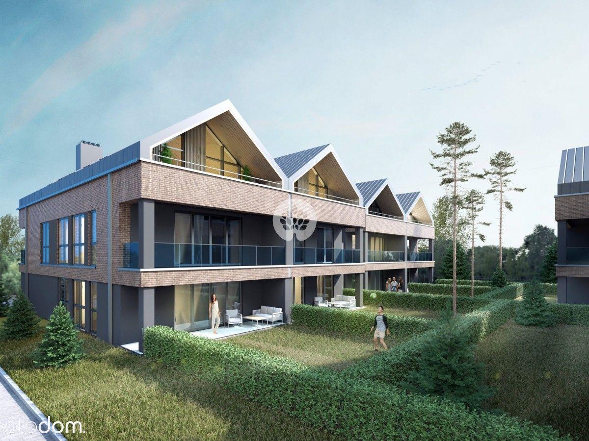 Mieszkanie z ogródkiem w nowoczesnym budynku