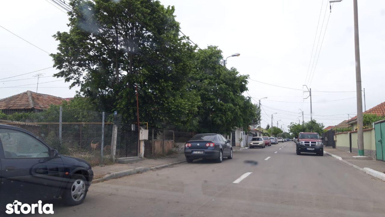 teren 900 mp cu casa demolabila, strada asfaltata