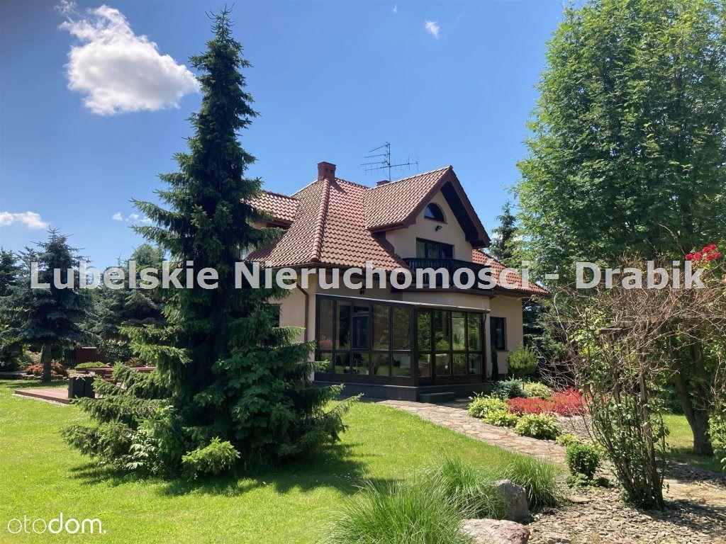 Atrakcyjny dom 238m2 z przepięknym ogrodem.