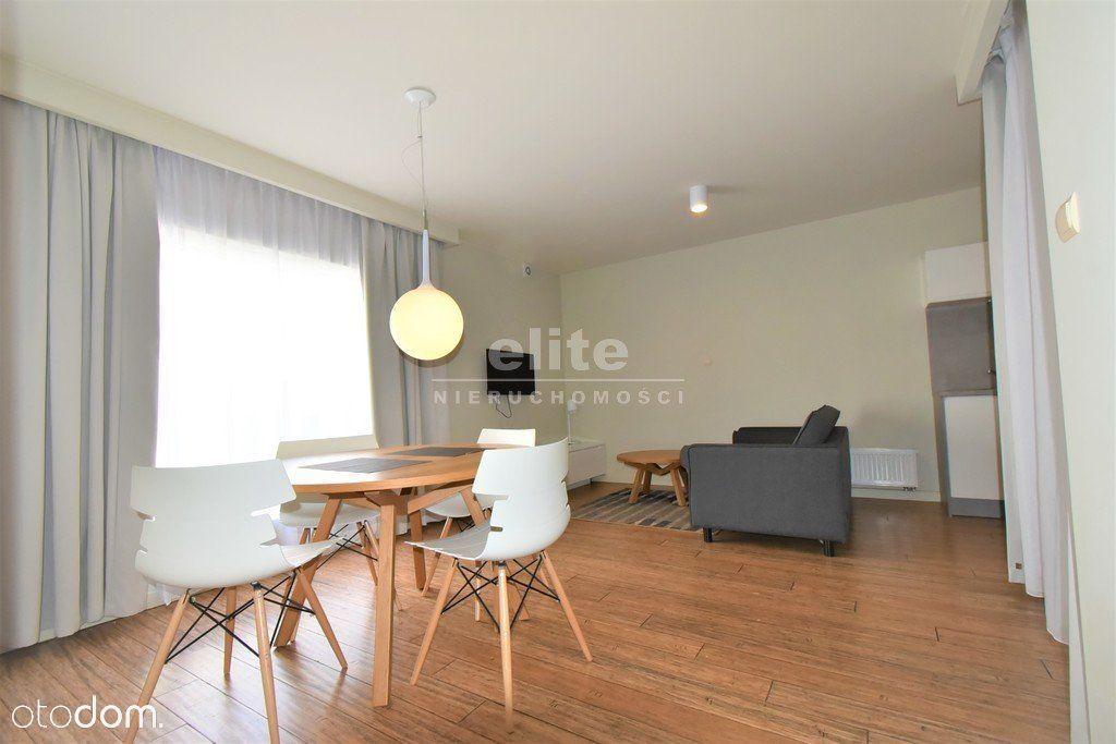 Apartament 52,4m2+17m patio m. postojowe