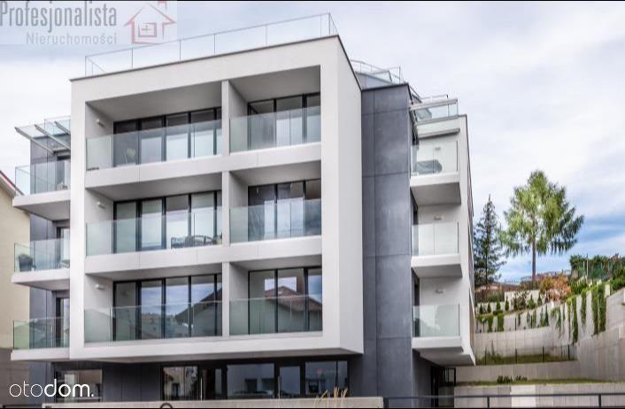 Apartament z 2014r. 3 pokoje,balkon,hala garażowa.