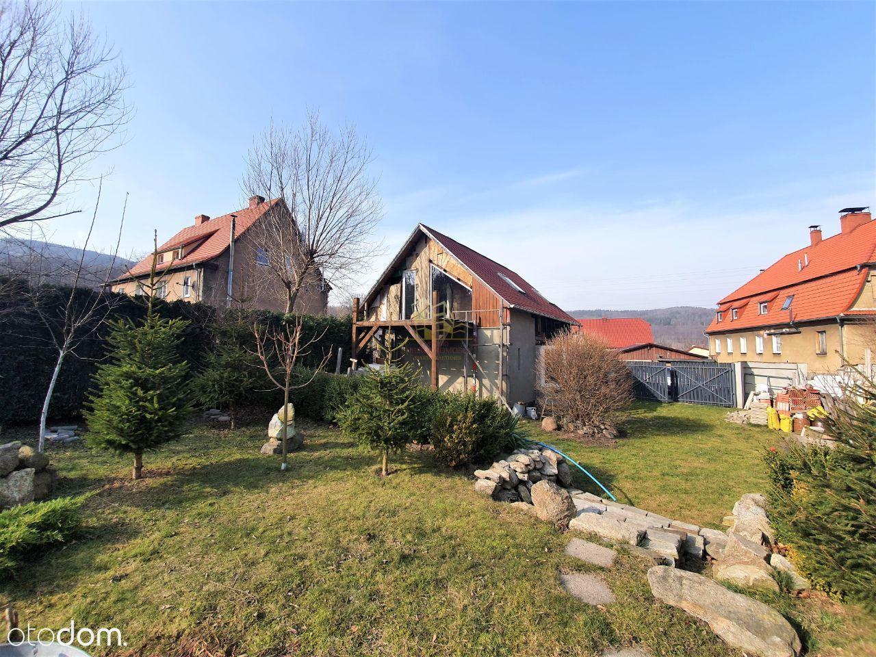 Działka z domem i pięknym ogrodem w Kamionkach!