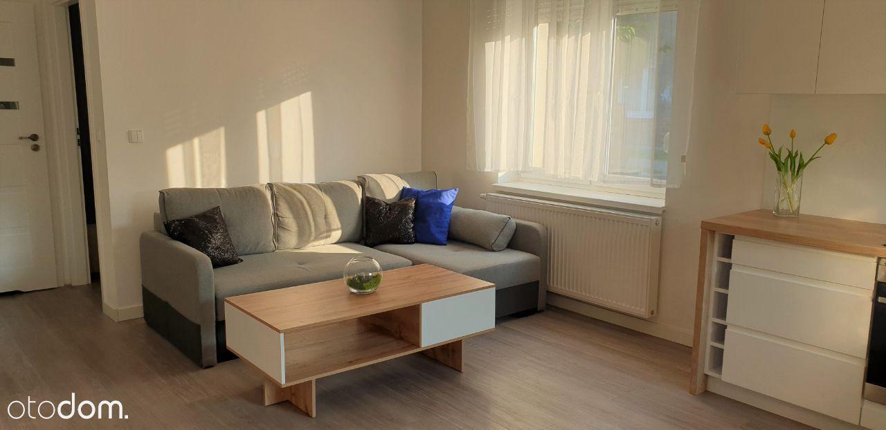 Atrakcyjny apartament z ogródkiem w centrum !