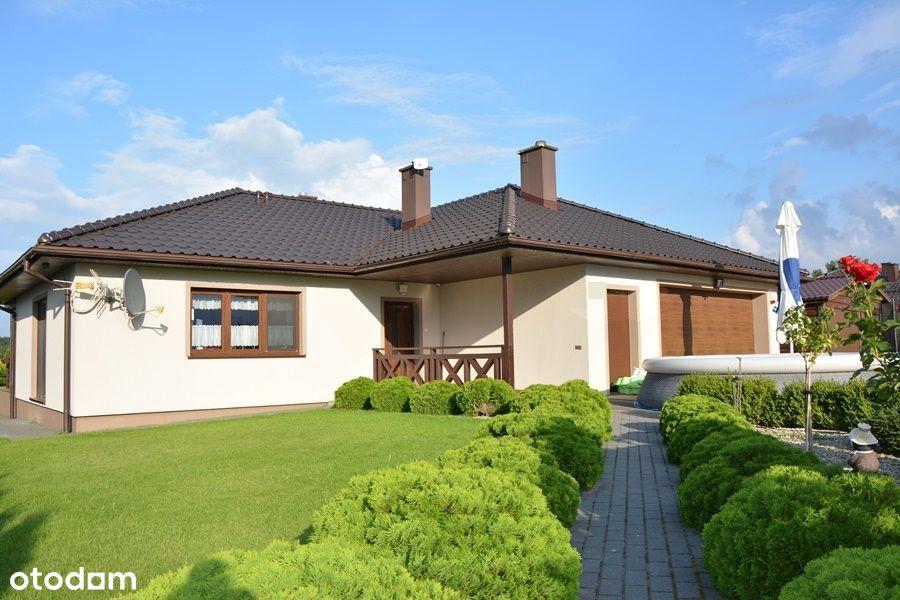 Dom z pięknym ogrodem i dwustanowiskowym garażem