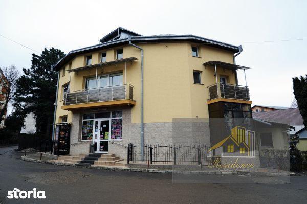 Casa + Spatiu comercial la parter (magazin)