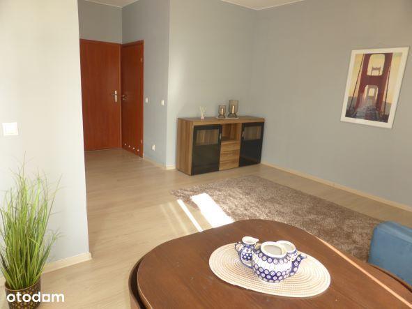 Przytulny apartament 2 pokojowy z tarasem i windą.