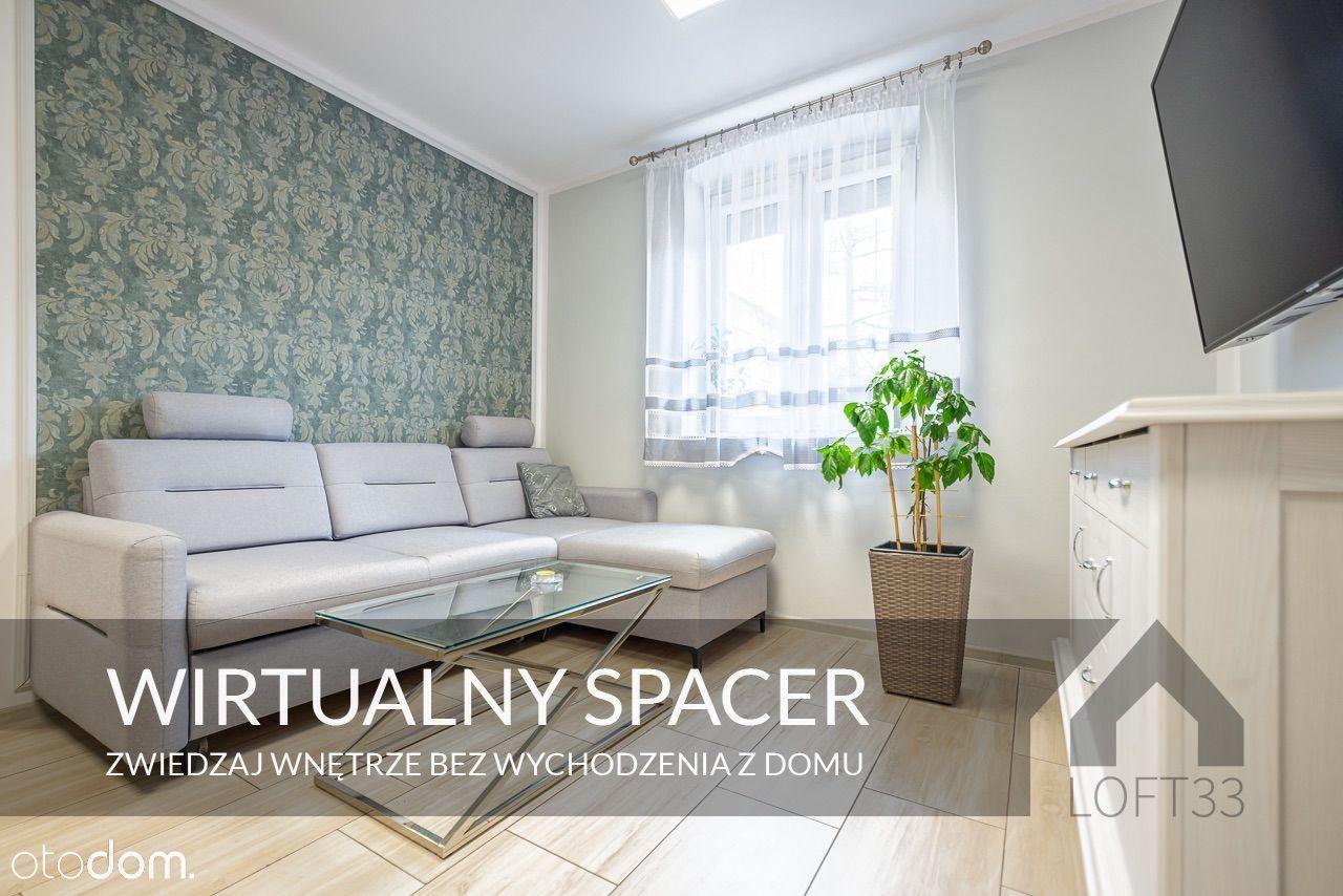 Wyposażone mieszkanie o ogródkiem i garażem