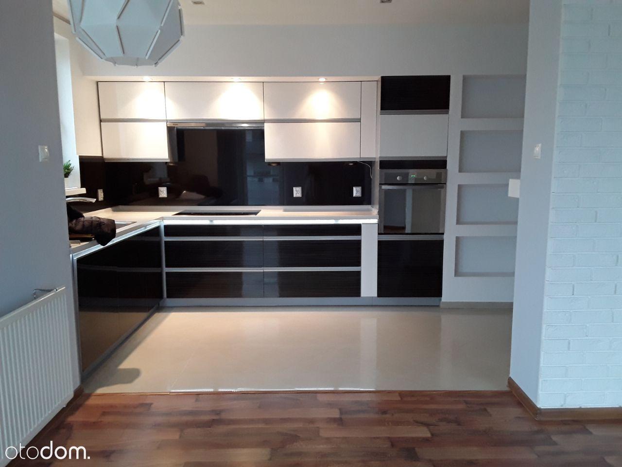 Mieszkanie 3-pokojowe z balkonem i garażem 77 m2