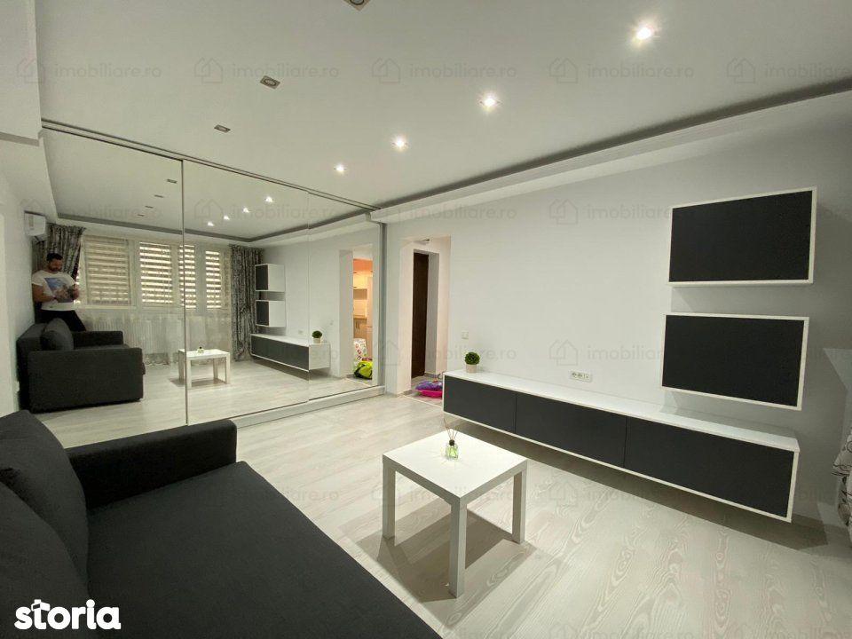 Apartament 2 cam Stefan cel Mare renovat mobilat ID 13033