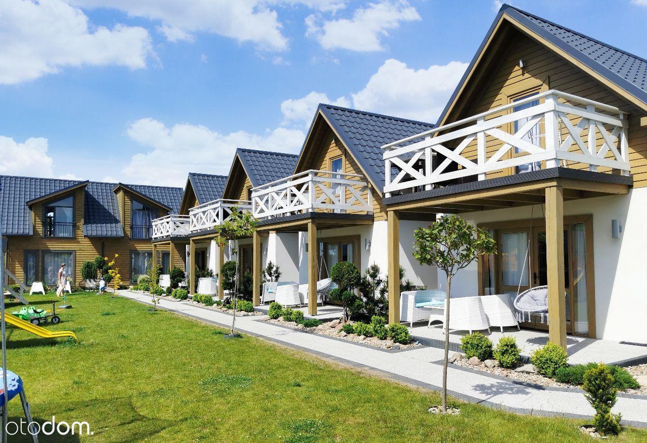 Kompleks Domków i Apartamentów w Łebie / Nowęcin
