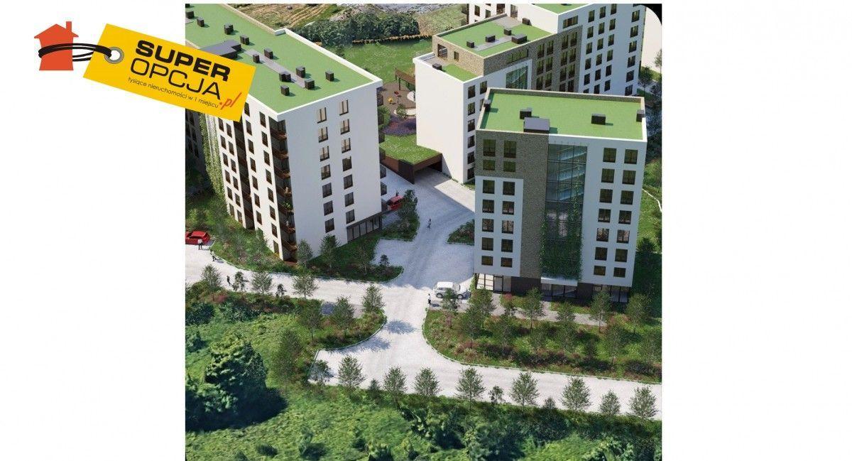Witryny, nowe osiedle, parking, pewna inwestycja