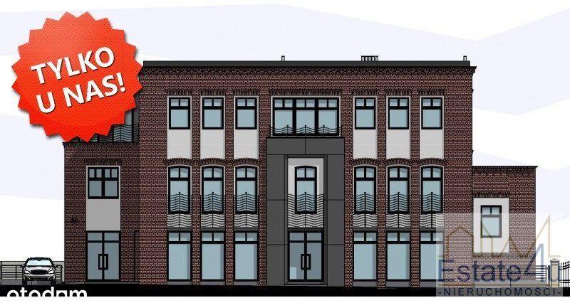Budynek biurowo-usługowy przy ruchliwej ulicy