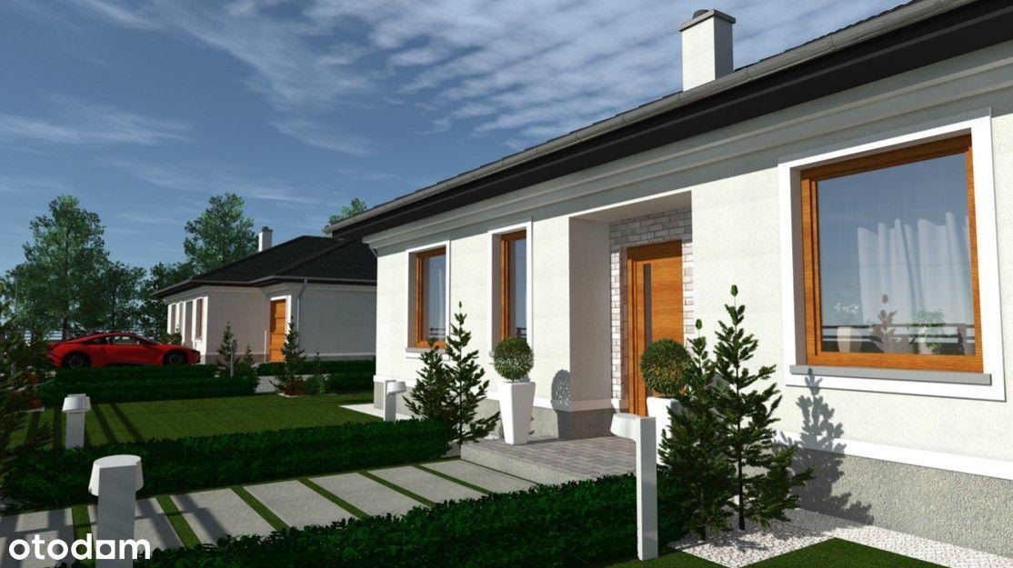 Nowe domy parterowe w otoczeniu lasów