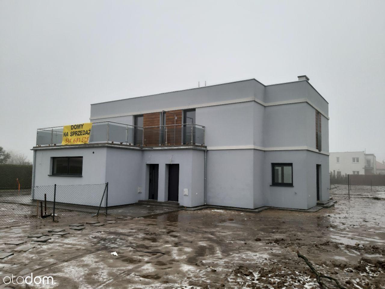 Nowoczesny dom dwulokalowy w Poznaniu