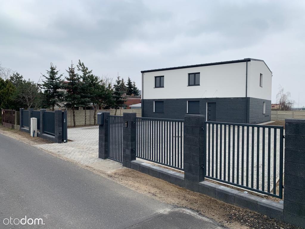 Nowy dom z ogrodem na biuro , salon lub klinikę