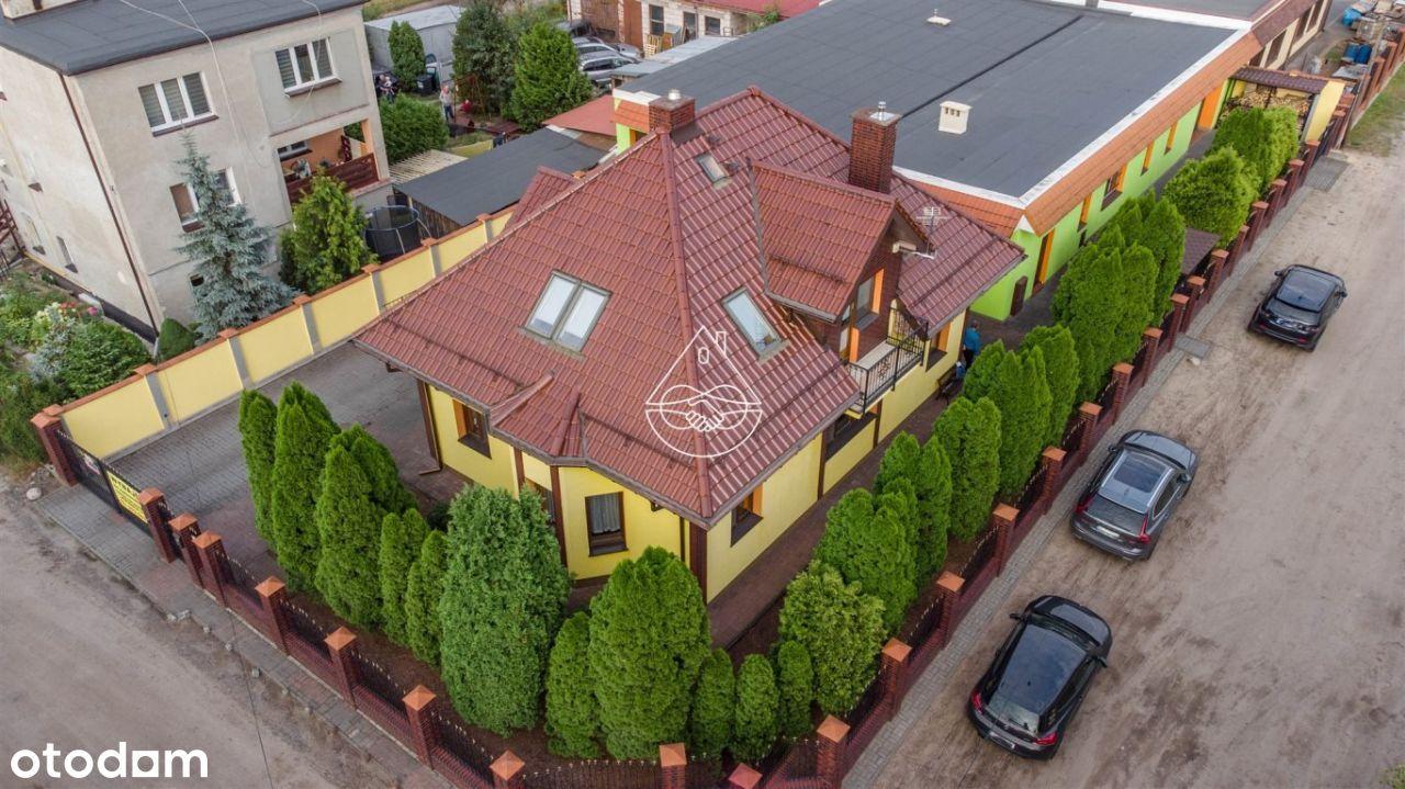 Niezależny dom z budynkiem usługowo-magazynowym