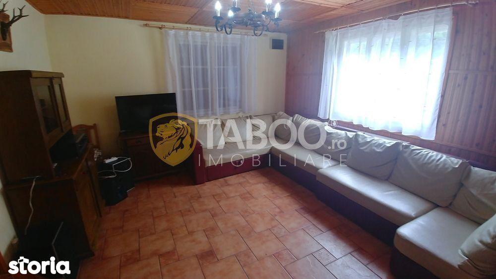 Cabana cu 8 camere de vanzare in Raul Sadului judetul Sibiu