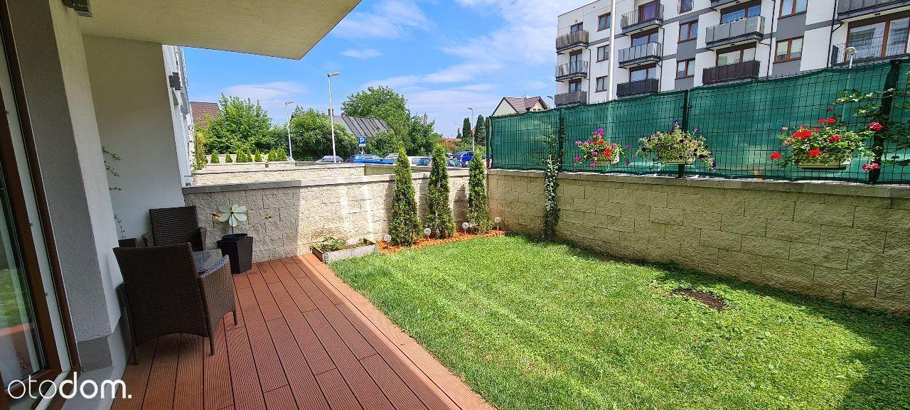 Sprzedam mieszkanie z dwoma ogródkami i garażami