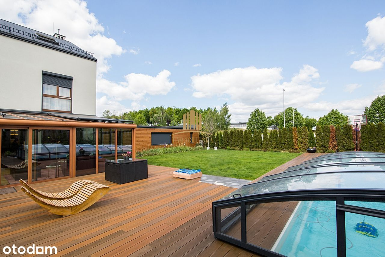 A luxury house with a swimming pool and a lift