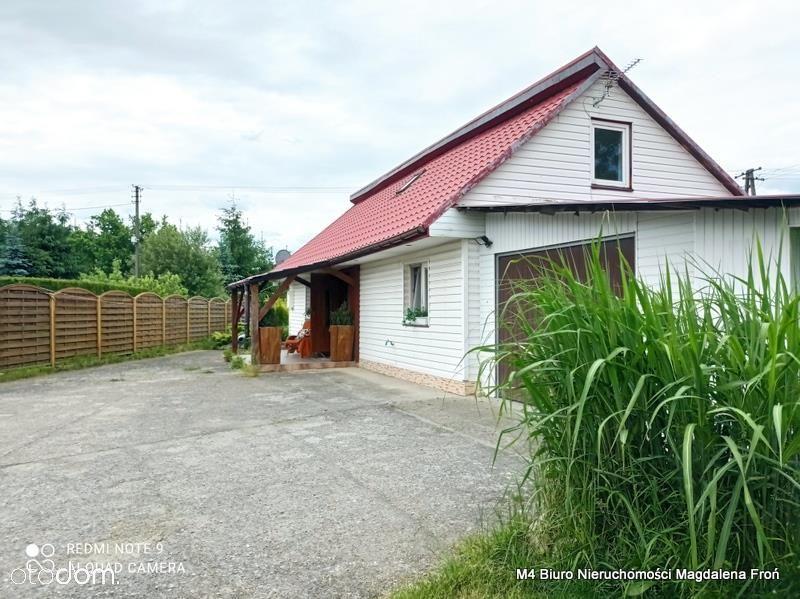Podkarpacie-mały biały domek pod Krosnem.