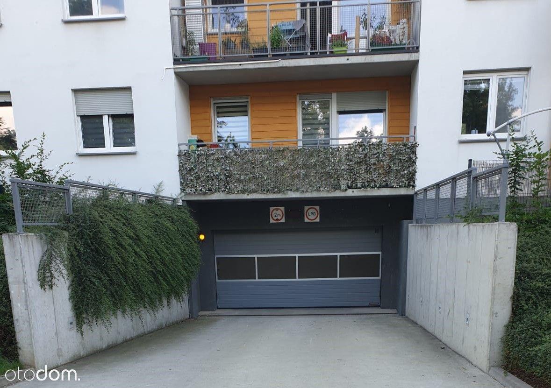 Podwójne miejsce garażowe+komórka- OLIMPIA PORT
