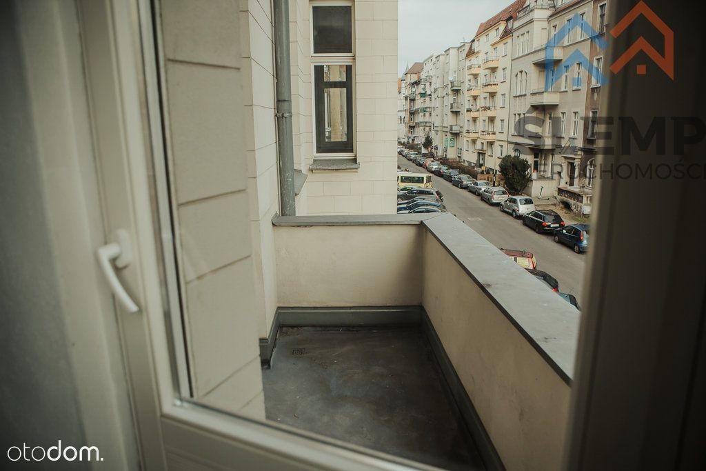 Apartament z tarasem w eleganckiej kamienicy