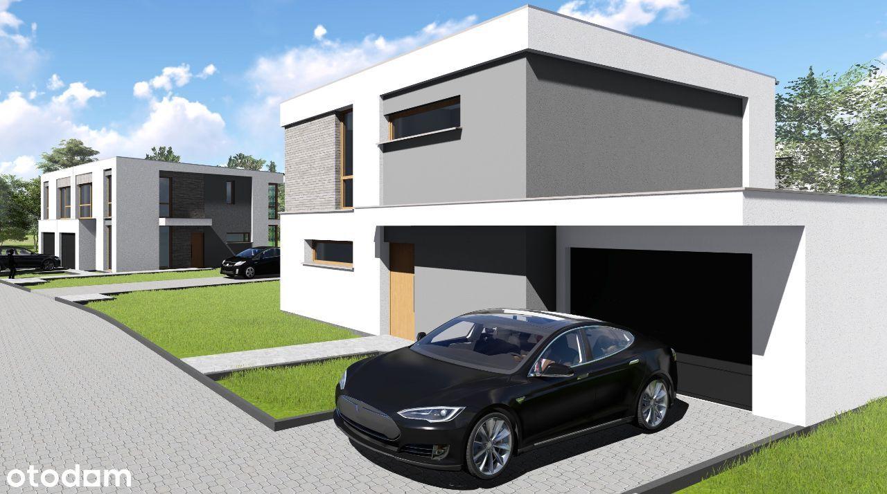 Duże domy z garażem - duża działka