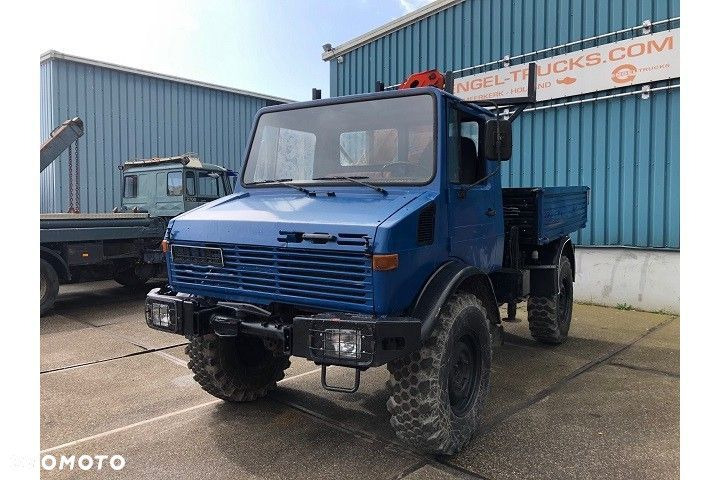 Mercedes-Benz UNIMOG 4x4 WITH OPEN BOX AND PALFINGER CRANE (FULL STEEL ...  Mercedes Benz Unimog 4x4 With Open BOX AND Palfinger Crane Full Steel - 1