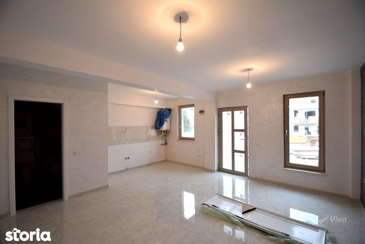 Apartament cu 3 camere, parcare si gradina intabulate, zona Popas