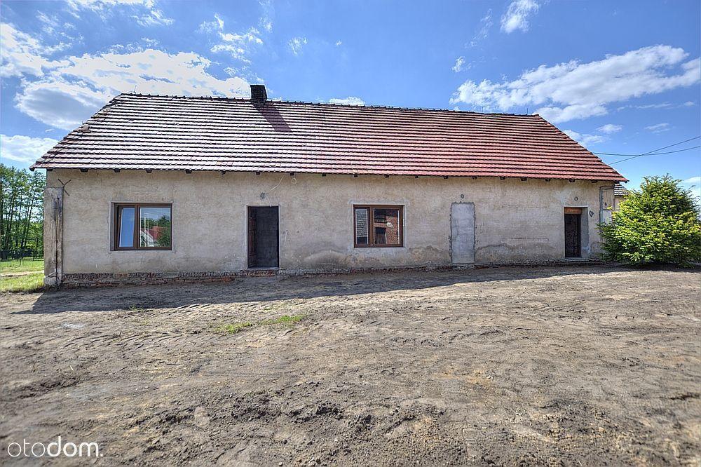 Parterowy dom z dużą działką w Bażanach