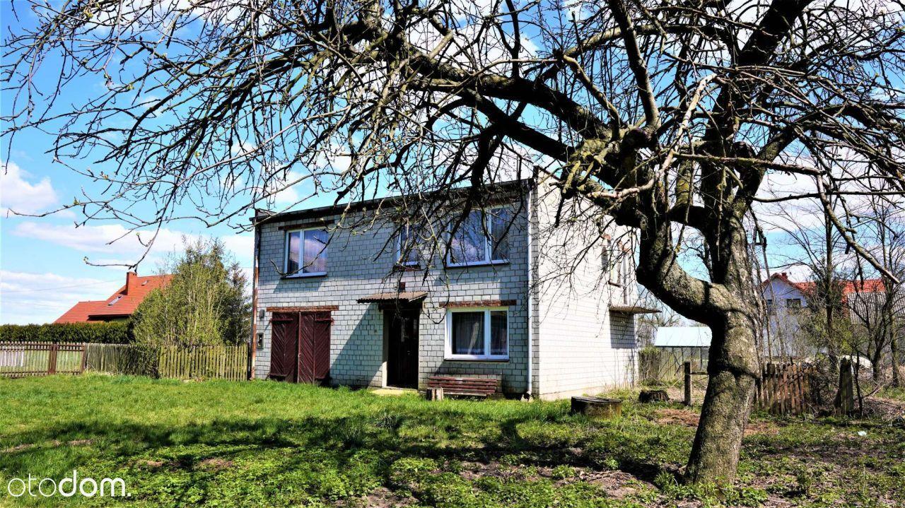 dom z budynkami i gospodarstwem rolnym