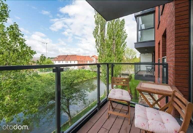Słoneczne mieszkanie z widokiem na rzekę