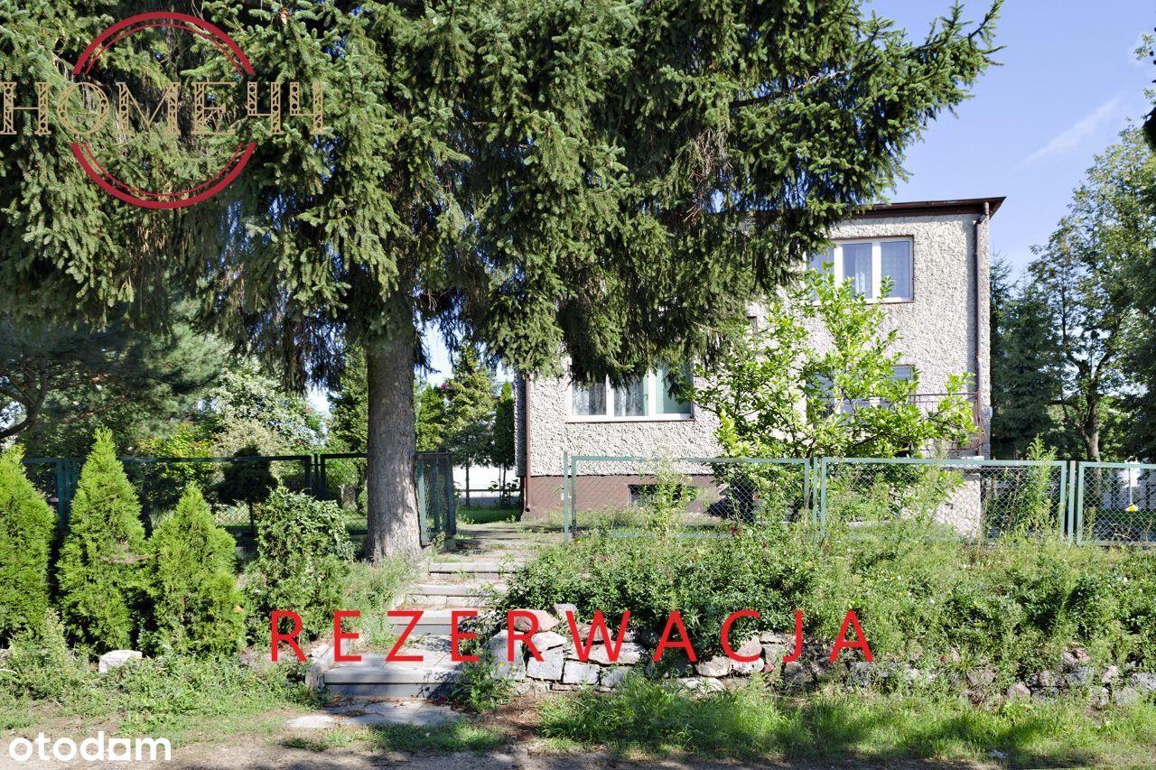 Dom z warszatem na zadbanej, zielonej posesji