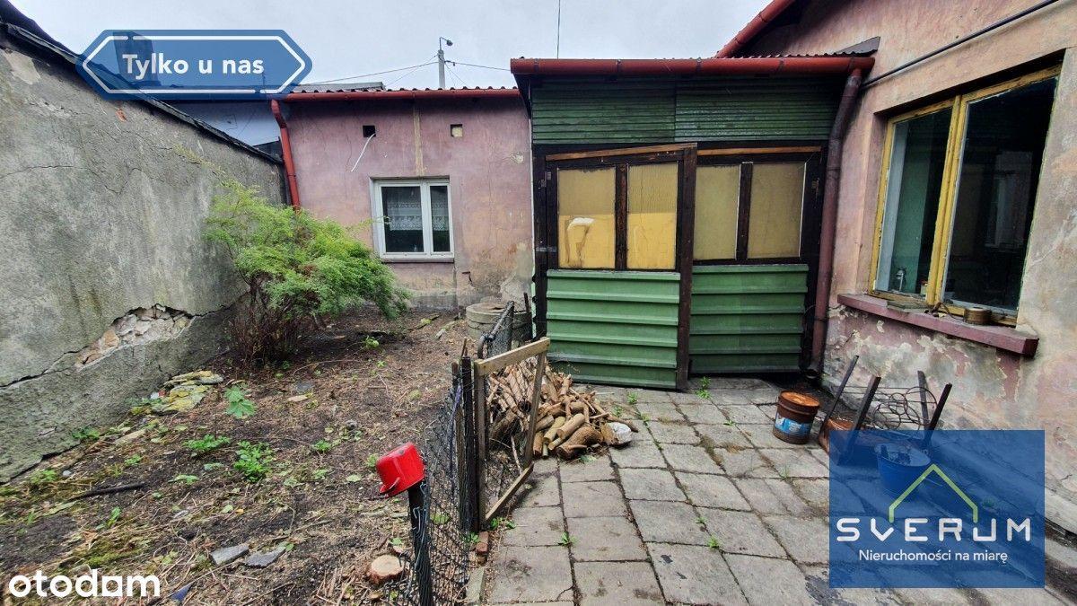 Dom w Żarkach w zabudowie szeregowej. Do remontu.