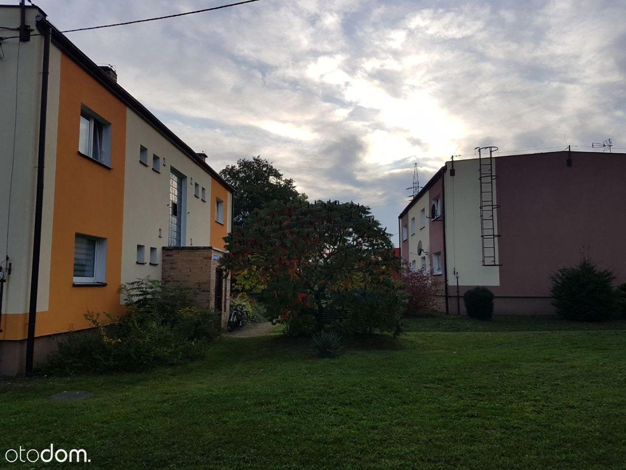 Mieszkanie z ogrodem, piwnicą, garażem i pom. gosp