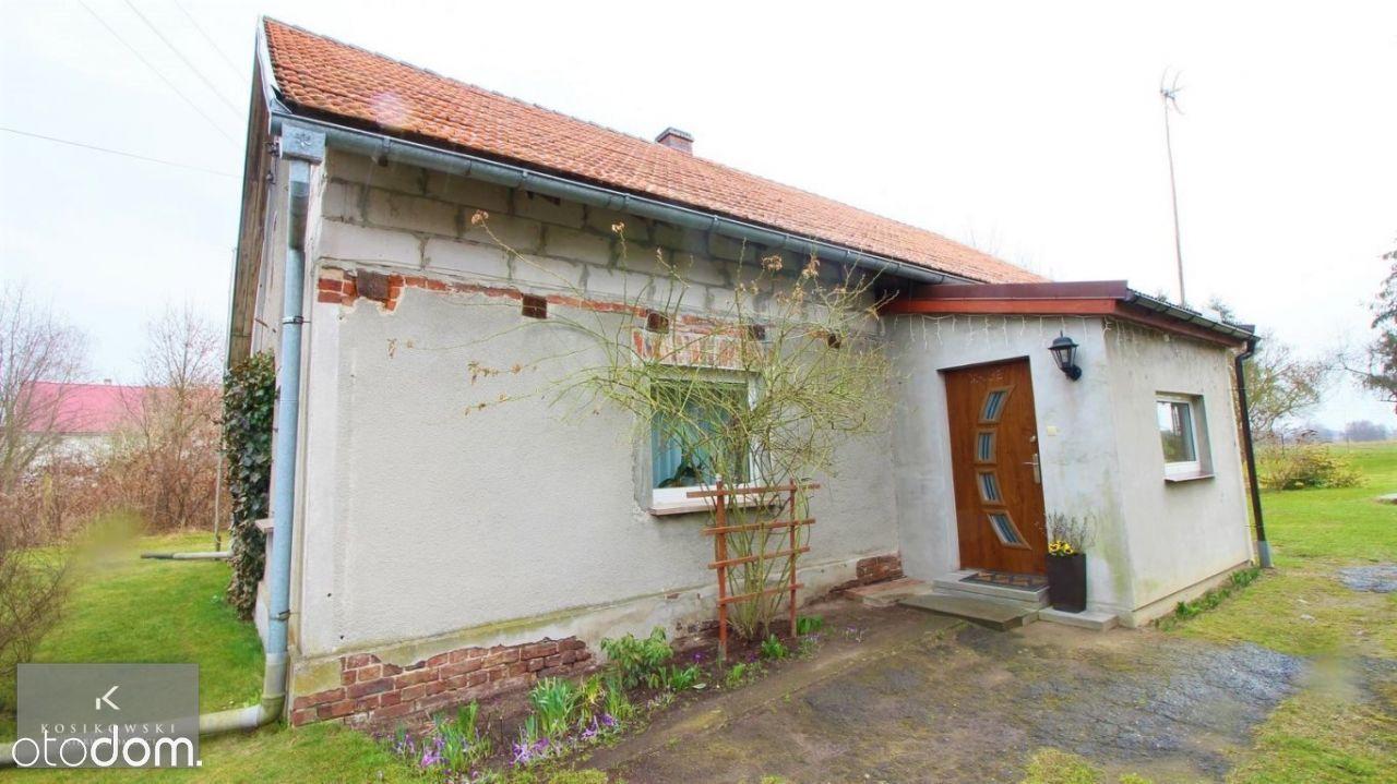 Mały, wolnostojący dom ok. 110 m2, działka 26 arów