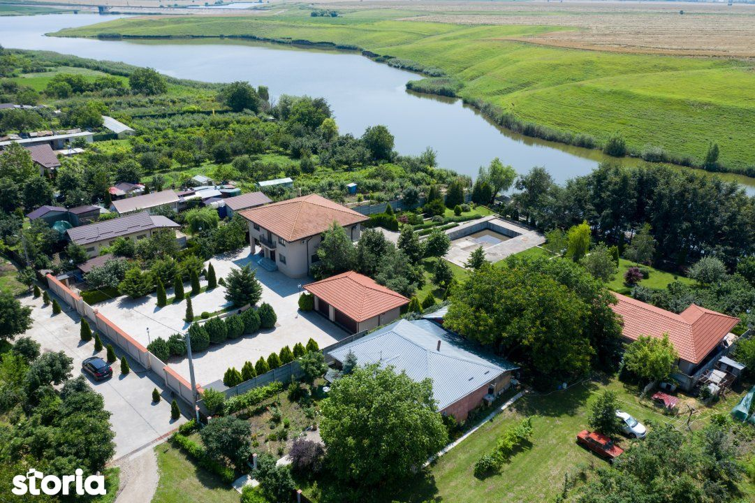 Vila si casa de oaspeti, Belciugatele, pe malul lacului.