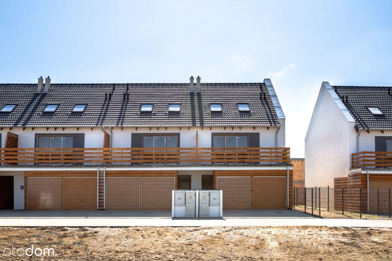 Dwupoziomowe mieszkanie z garażem, ogrodem Dachowa