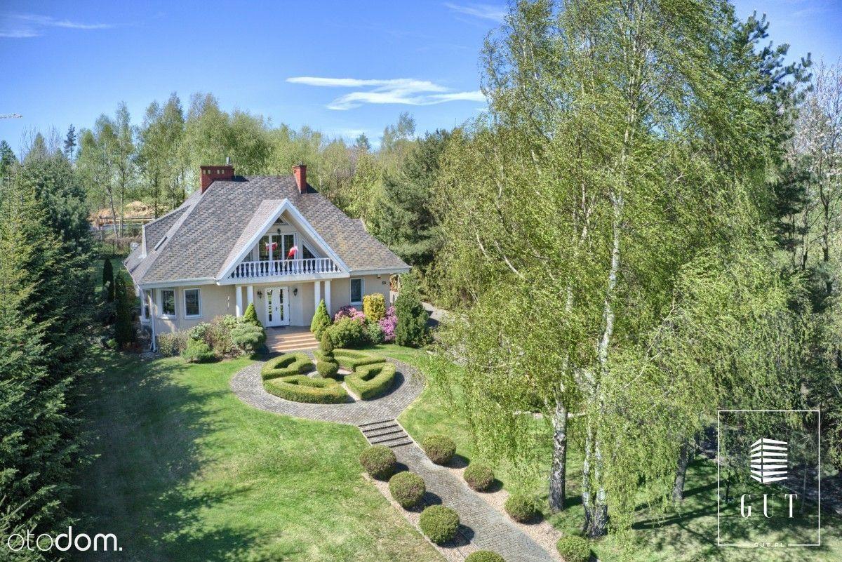 Komfortowy dom z pięknym ogrodem.