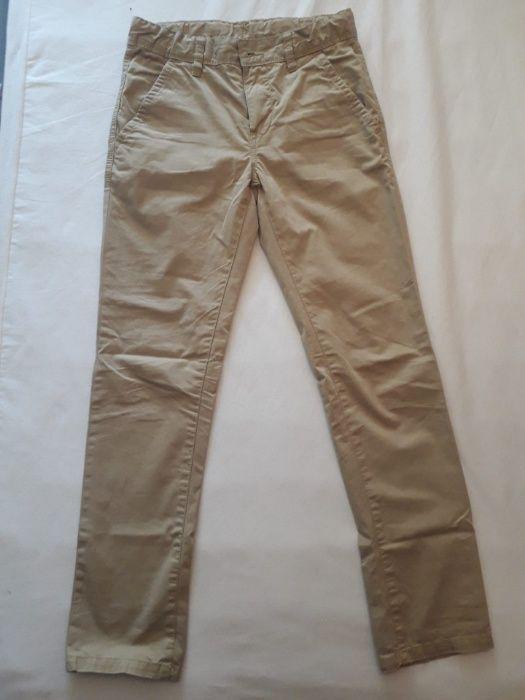 4b97e7d20 Calças Chino Benetton tamanho 10 anos - Guimarães - Calças Chino de rapaz  Beges, praticamente