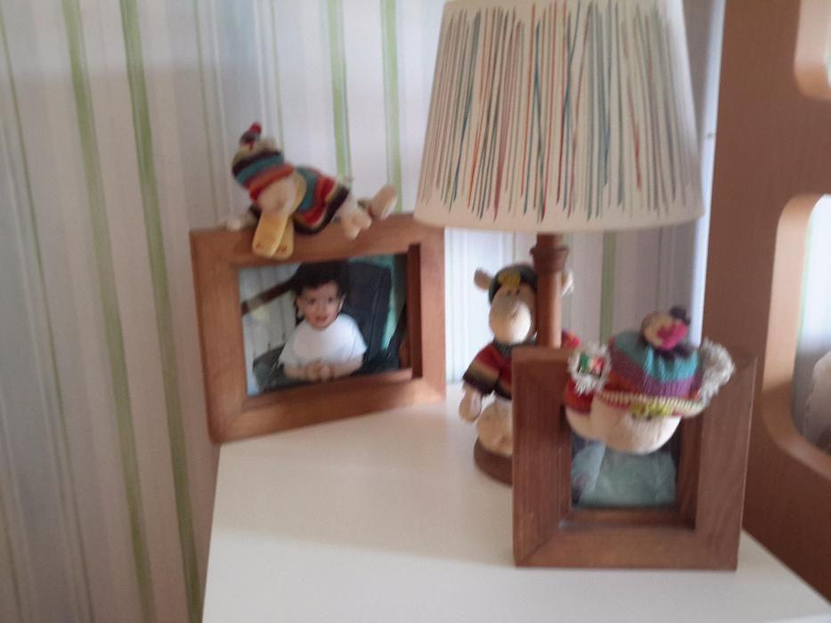 Candeeiro e porta retratos de criança
