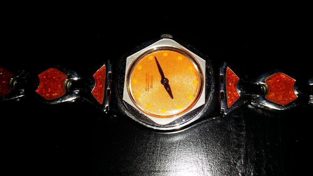 10aeb12f629 Relógio Swatch Prateado Laranja