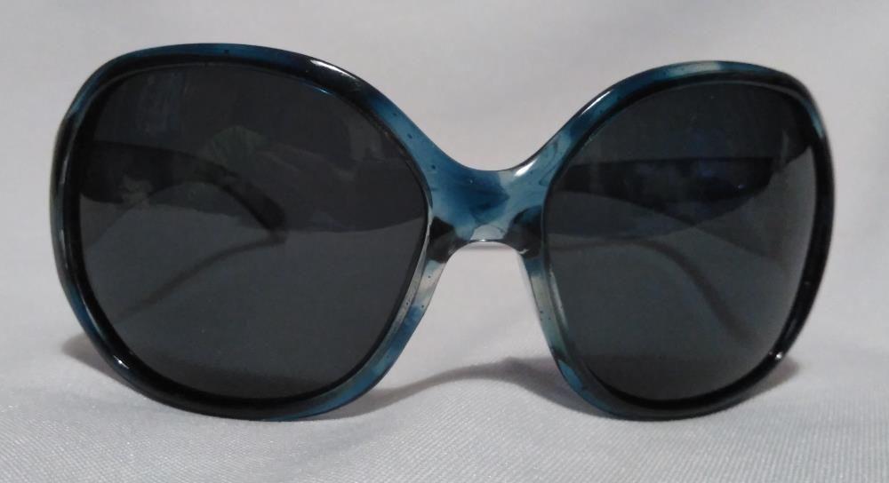 Oculos de sol senhora