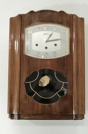 Relógio de parede antigo da marca Reguladora.