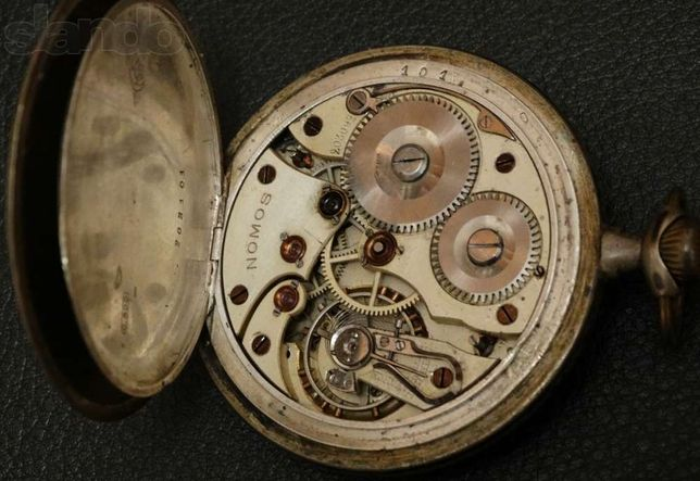 Старинный карманные часы Nomos Glashutte