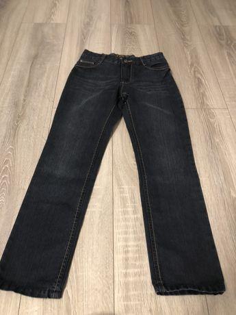 Nowe jeansy spodnie roz.140