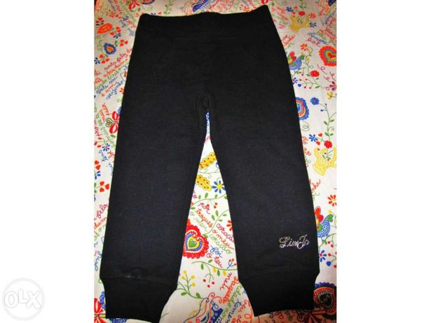 Calças infantis pretas com bolso canguru NOVAS