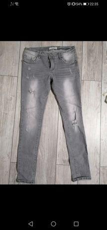 Szare jeansy z przetarciami L